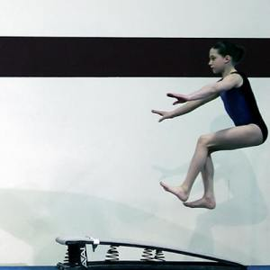 JUMP ON THE LINE: Speed and hitting the sweet spot--the line--on springboard is key to a Huge Vault!